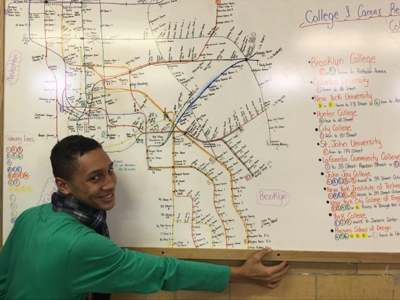 student with map